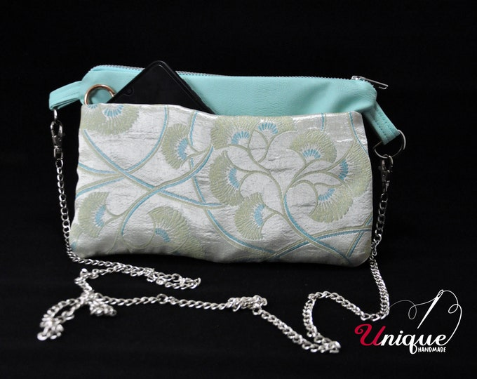 Beautiful cross-body zip-up bag with frond-back pockets