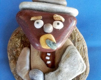 The Man With The Hat Stone and pebbles art