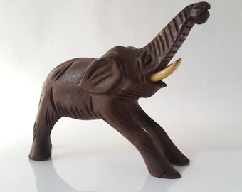 vintage small Ebony elephant. dark brown wood animal sculpture