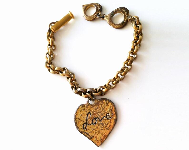 ed2fb269e3 YSL charm, Yves Saint Laurent bracelet, womens jewelry, womens bracelet,  vintage charm, Saint Laurent, vintage jewelry, vintage bracelet