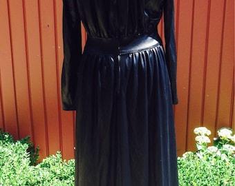 2aecf8d7c8 get on the bus in this fantastic wet look 1970s vintage Lee Bender Bus Stop  black wet look long sleeve maxi dress