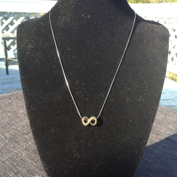 Sterling silver chain with infinite pendant