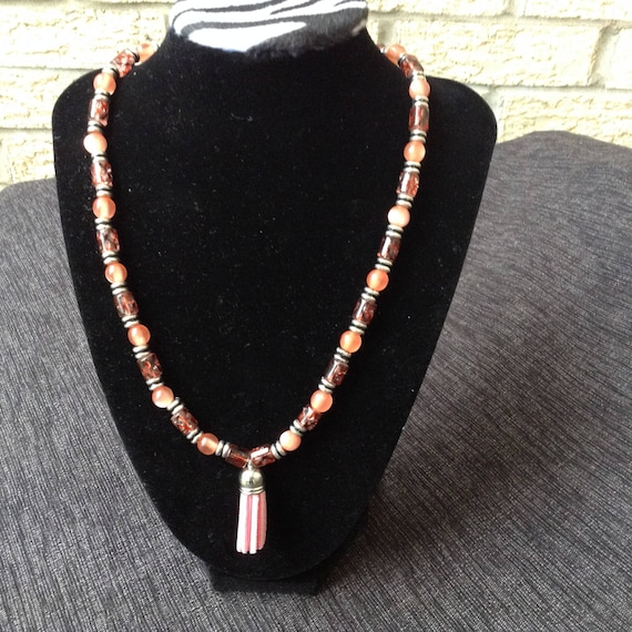 Glass bead necklace with charm