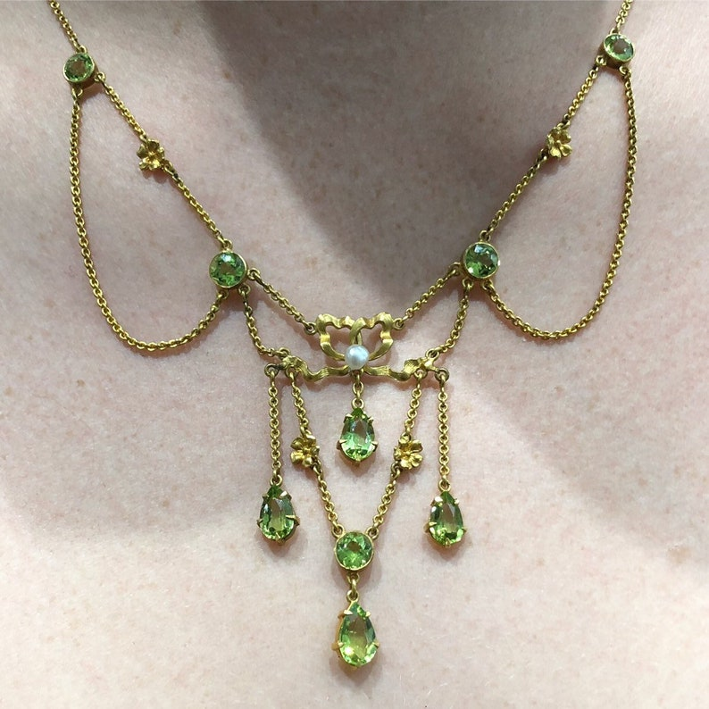 26a773bd79518 Antique Edwardian peridot and natural pearl necklace, from about 1910