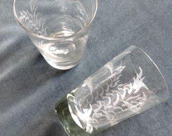 Two large glasses has liqueur, cocktail, 1920s, fern pattern