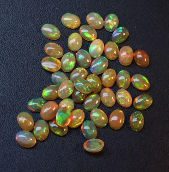 100 % naturel éthiopienne Opal qualité AAA + Multi Multi Multi feu Cabochon opale feu Super ovale Taille 5x7mm 10 PCs Lot en vrac pierre gemme opale @Code #OP043 961bfe