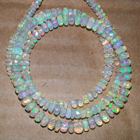 Natural AAA quality Ethiopian Opal smooth plain rondelle beads size 4.5-5.75mm sold per 16-inch strand GW884