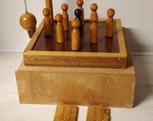 Wooden bowling game with 9 cones and score plates