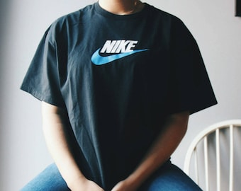 6918a4791cfb Vintage Black Nike T-shirt With Blue Swoop