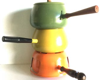Instant collection: Fondue pot trio in yellow, orange, and green