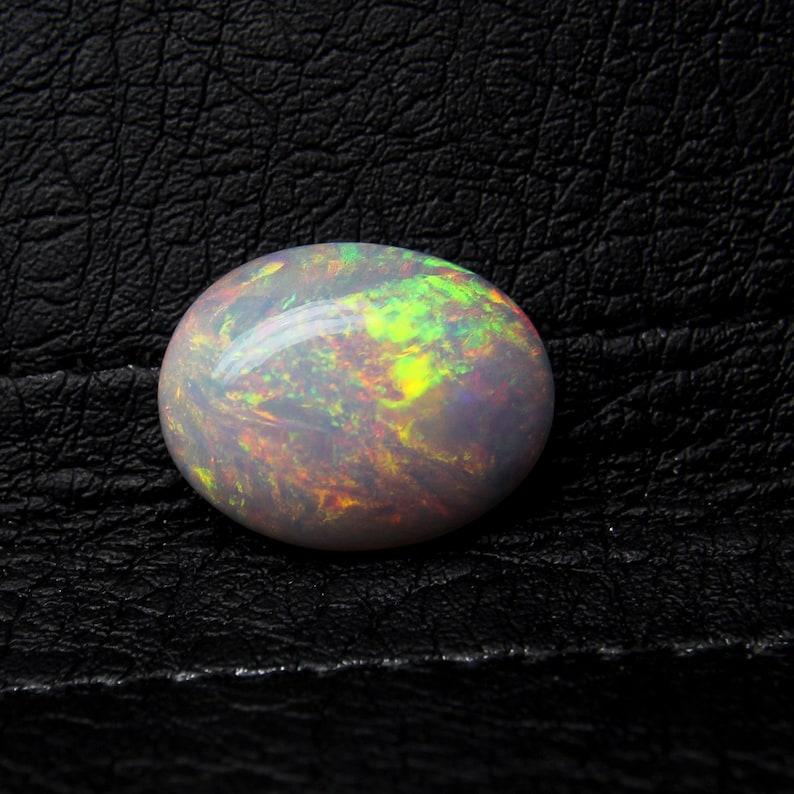 Natural Beautiful Ethiopian Welo Fire Opal Multi-Fire Oval  Cabochon Gemstone .