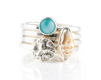 Haleiwa - A unique ocean stacking ring combo of the ocean gemstone larimar, a fine silver disc cast from a piece of coral and tiny sea shell