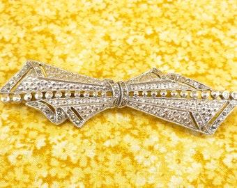 Vintage brooch - long, silver-toned metal, filigree/milgrain details, black/hematite rhinestones