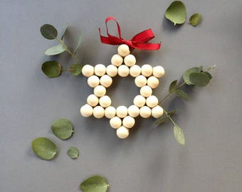 Star with wooden beads, nice decoration.