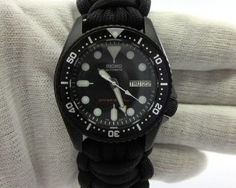 f5530f72d Brand New Seiko mod MEDIUM SKX013 all black Divers watch Cerakote military  with hand crafted Paracord strap