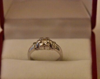 14kt white gold ring with flower motif . Set with 7 zircons, size 53, weight 5gr. One of a kind, handcrafted.