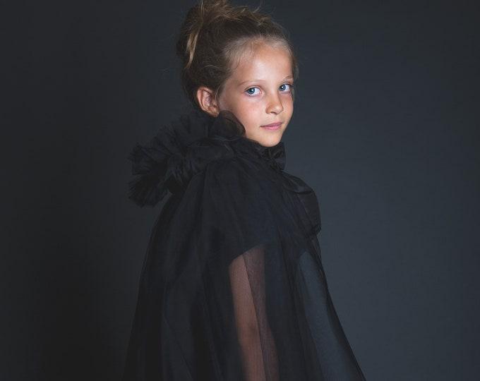 Black tulle cape, taffeta knot