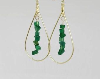Green glass cats eye chip hoop earrings.