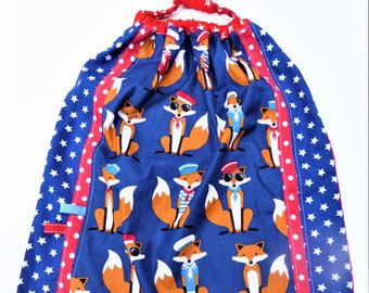 Elasticated towel to put on single, large bib, towel maternal and foxes.