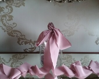 """Hand dyed crepe de chine silk ribbon in a dusky mauve colour, measuring approx 2"""" x 3 yards"""