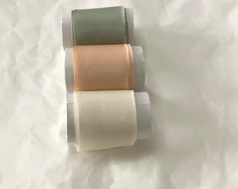 """Hand dyed set of 3 useful shades in peach-apricot, ivory & sage raw edged silk ribbons , each roll approx 2""""x3m with no joins"""