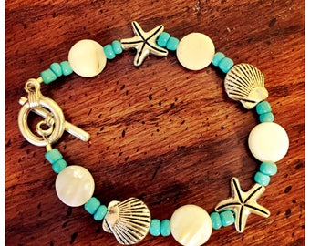 Beach inspired bracelet with gorgeous shell and starfish embellishments