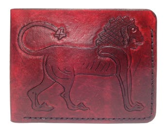 Red leather wallet, hand-tooled lion