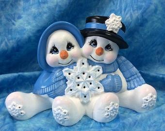 Loving, lighted snowman couple