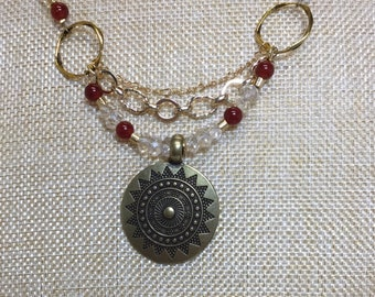 Brass pendant with citrine and carnelian