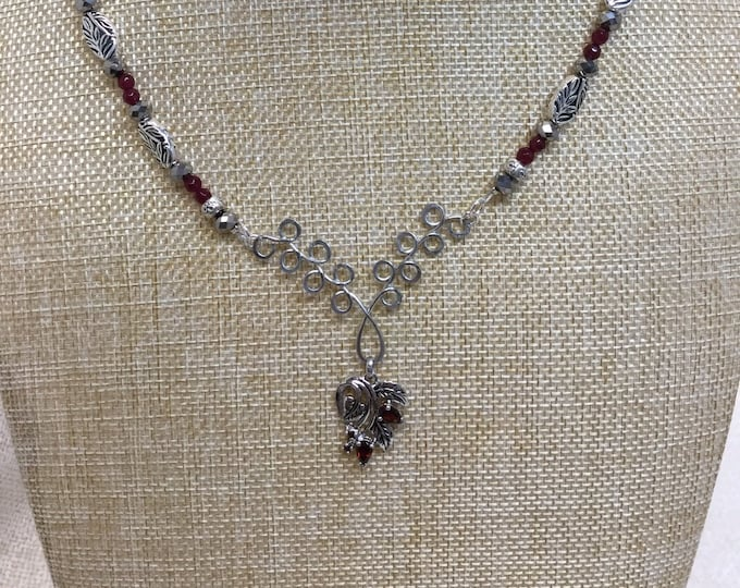 Ruby colored flower, garnets, and silver