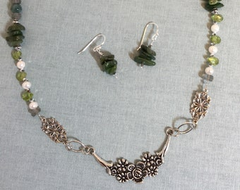 Single strand necklace with pewter focal element, peridot, and New Zealand jade