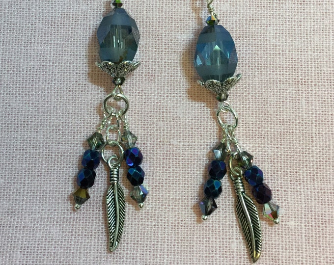 Funky blue dangle earrings with sterling silver feathers