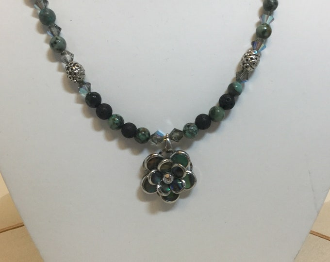 NZ Paua shell flower necklace with African turquoise, sandstone, labradorite, and Swarovski crystals.