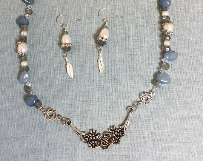 Single strand necklace with pewter focal design and chunky aquamarine