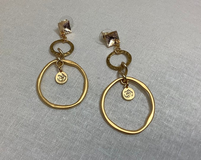 Double hoop earrings with Om symbol.