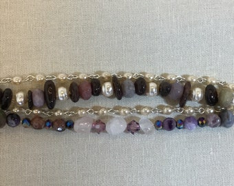 Four strand charm bracelet with garnet, moonstone, amethyst, and jasper