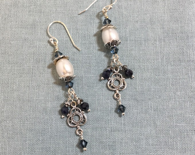 White pearl dangles with celtic charm and sapphires