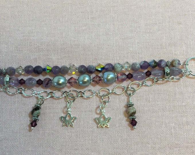 Triple strand bracelet with amethyst, Swarovski crystals, and pearls