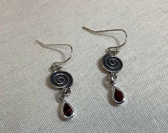 Spirals and ruby charms