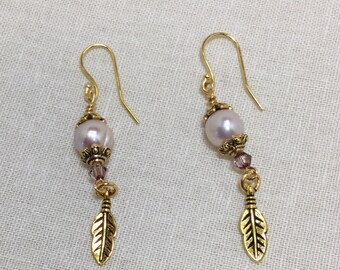 Pearl and feather dangle earrings