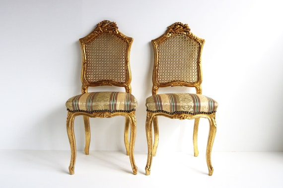 couplepair Midcentury decorative wooden gold painted woodcarvedchairs webbing  back french louis style