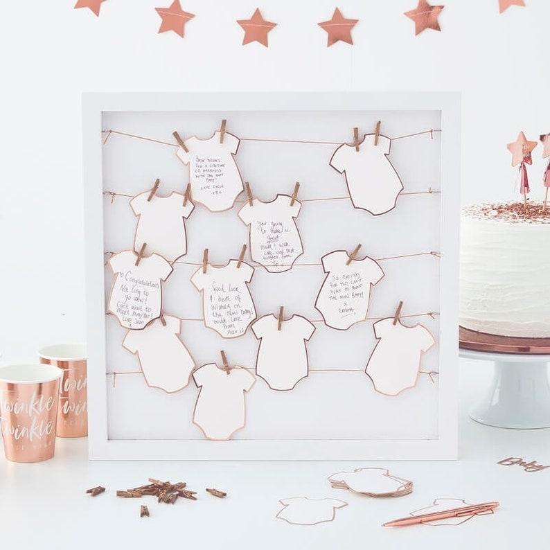 Livre d'or baby shower cadre 3D. Belle idée d'animation baby shower pour garder de beaux souvenirs !