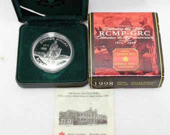 1998 Canadian 125th Anniversary Royal Canadian Mounted Police Proof Silver Dollar Coin