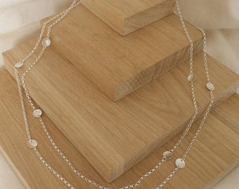 Necklace with textured discs in sterling silver