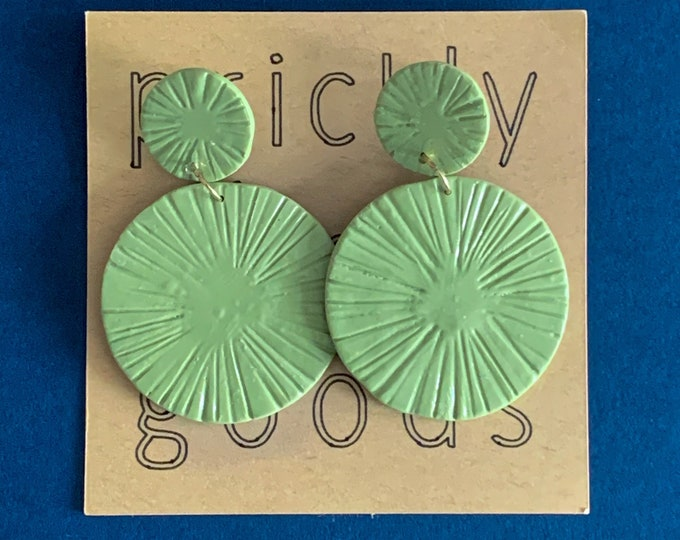 Carved disc earrings