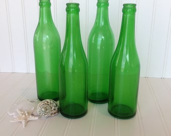 c283a01584df Lot of four green glass bottles Vintage green glass bottle decor Glass  bottle centerpiece Vintage glass bottles Antique bottles