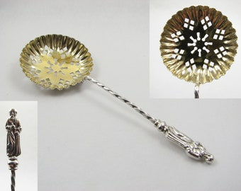 An Ornate Thomas Hayes Novelty Sterling Silver Mini Sugar Sifting Spoon with Figure Finial, 10.8 cm,  Birmingham  1900
