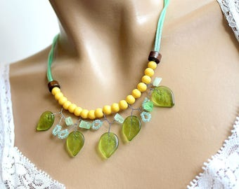 Necklace was green and yellow leaves of glass