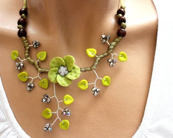 Necklace green floral beads and cold porcelain