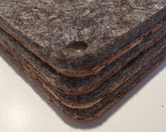 """A set of four handmade cork and traditional Russian """"valenki"""" style brown wool felt coasters"""